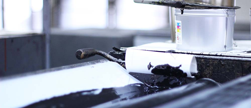 Black Ink in Offset Press Ink Fountain with Roller